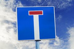 Dead end street traffic sign on sky background. Dead end street traffic sign on blue cloudy natural sky background Royalty Free Stock Photography