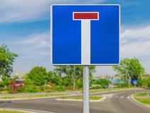 Dead end street traffic sign on road background. Dead end street traffic sign on city european road background Stock Photography