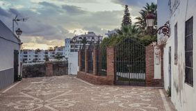Dead end in the town. Nerja, Malaga, Spain - March 20, 2019: Sunset on a narrow dead end with a outlook and a small garden stock image