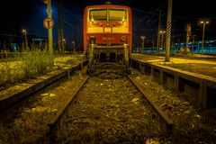 DEAD END with a train wagon at night, shot in low wide angle at a train station. Blind alley. Shot aside at Karlsruhe train station Germany 2017 Sign shows: You Stock Images