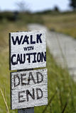 A Dead End Walk. A sign informing people of an unsafe walk that is also a dead end stock photography