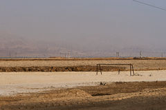 Dead football field near Dead Sea. Football field covered with the salt remained from the dried out Dead Sea water Stock Photography