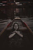 Dead girl in the boat Royalty Free Stock Images