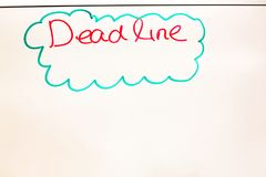 Dead line wording written on white board in the office Stock Photos