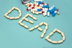 Dead made of Capsules and pills. Dead made of Capsules and  pills  on a blue background Stock Image
