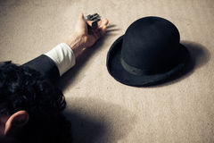 Dead man and hat on floor Stock Image
