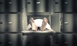 Man in the morgue. Dead man in the morgue stock photos
