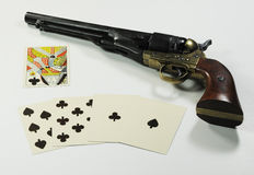 Dead Man's Hand. Aces and eights, the famous Dead Man's Hand with an army revolver.  The cards and the revolver are of the type used in the American West in the Stock Images