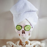 Dead man to take care of beauty. Skeleton in Spa salon. Royalty Free Stock Photos