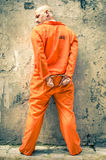 Dead Man Walking - Prisoner with Handcuffs standing proud. Portrait of a prisoner with orange clothes Stock Photography