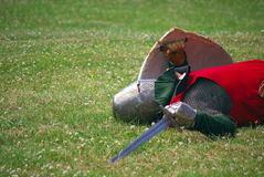Dead medieval knight. On grass at historical reenactment Stock Image