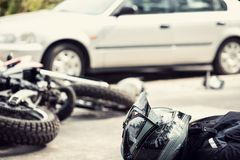 Dead motorcyclist on the road after traffic incident with a car. Concept photo stock images