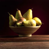 Dead nature. Composition made by pears and vassel Royalty Free Stock Photo