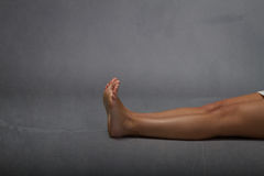 Dead person lying down. Dark background Stock Image