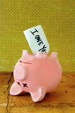Dead Piggy Bank. With IOU note sticking out of his belly Stock Image