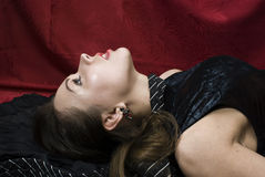 Dead pretty woman. Crime scene: young strangled woman. Studio shot Royalty Free Stock Photography