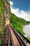 Dead railway beside cliff along Kwai river Stock Photos