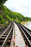 Dead railway beside cliff, along Kwai river Stock Photos