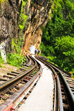 Dead railway beside cliff, along Kwai river Stock Images
