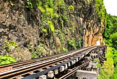 Dead railway beside cliff, along Kwai river Royalty Free Stock Images