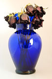 Dead Roses in a blue Glass Vase Royalty Free Stock Image