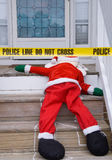 Dead Santa. The dead body of Santa Claus at a crime scene Stock Image