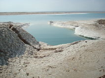 Dead Sea. View over dead sea, dry earth and salt crystals jordan Royalty Free Stock Photography