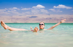 Dead Sea. Beauty Woman Lying On Water. Dead Sea. Israel stock photography