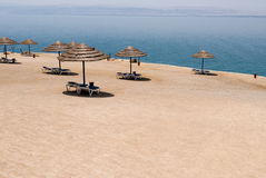 Dead Sea beach. With umblrella Stock Photography