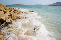 Dead Sea coast. Salt and stones on the bank of Dead Sea, Israel Royalty Free Stock Images