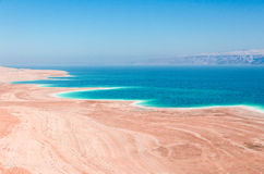 Dead Sea coastline in desert uninhabited extraterrestrial landscape Stock Photos