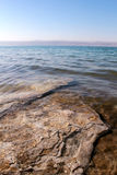 Dead Sea coastline, salt crystals in sand Stock Photos