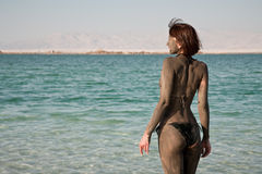 Dead Sea dirt. Girl with dirt on dead sea Stock Photo