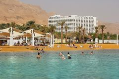 Vacationers and tourists bathe in the Dead Sea, Israel. Dead Sea, Ein Bokek, Israel - october 19: vacationers and tourists bathe in the Dead Sea on the Royalty Free Stock Images