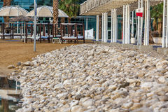 Dead Sea empty morning beach with beach beds Royalty Free Stock Photos