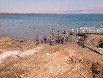 DEAD SEA, ISRAEL - Juli 14: Bathing brine  and mud in the Dead S Stock Images