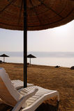 Dead Sea, Jordan. The Dead Sea, also called the Salt Sea, is a salt lake bordering Israel and the West Bank. Its surface and shores are the lowest elevation on Royalty Free Stock Photos