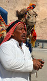 DEAD SEA LEVEL ISRAEL 10-29-16: Portrait of a Bedouin and his camel. Negev Bedouin are traditionally pastoral nomadic Arab tribes Royalty Free Stock Photography