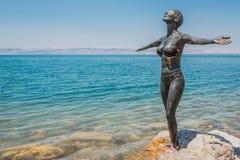 Dead Sea mud body care treatment Jordan. One  woman applying Dead Sea mud body care treatment in Jordan Stock Photography
