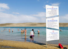 Dead Sea. People swim and sunbathe. Royalty Free Stock Photography