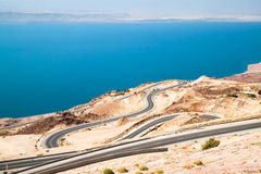 Dead sea road area, curvy highway. With panoramic view from Jordan side on Israel and Palestine cost. Jordan Stock Image