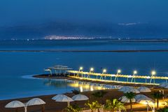 Dead Sea, is a salt lake bordering Jordan to the north, and Israel to the west. Its surface and shores are 430.5 metres 1,412 ft below sea level. Evening shot stock photography