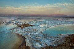 Dead Sea, is a salt lake bordering Jordan to the north, and Israel to the west. Its surface and shores are 430.5 metres 1,412 ft below sea level. Sea salt stock photos