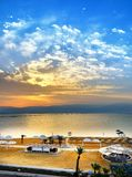 Dead Sea, is a salt lake bordering Jordan to the north, and Israel to the west. Its surface and shores are 430.5 metres 1,412 ft below sea level. Sunrise by royalty free stock image