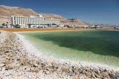 Dead sea salt shore. Ein Bokek, Israel stock photography