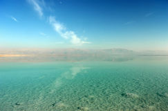 Dead sea scenery. Beautiful colored Dead Sea scenery with salt on lake bottom and Jordan hills on background, Israel Stock Photography