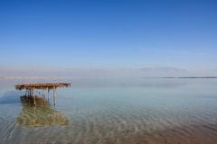 Dead Sea view, Ein Bokek, Israel. Beautiful colored Dead Sea scenery with gazebo and salt on lake bottom and Jordan hills on background, Israel Royalty Free Stock Images