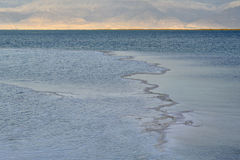 Dead sea water surface at sunset. Royalty Free Stock Image