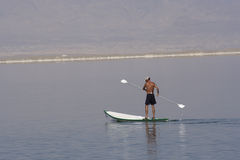 Dead Seas lifeguard. Seaman of the Dead Sea in canoe with the paddle Royalty Free Stock Image