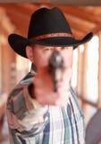 Dead Serious Cowboy. Serious cowboy aiming pistol at camera Stock Photos